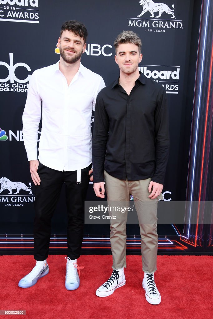 Recording artists Alex Pall (L) and Andrew Taggart of musical group The Chainsmokers attend the 2018 Billboard Music Awards at MGM Grand Garden Arena on May 20, 2018 in Las Vegas, Nevada.