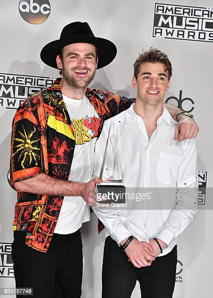 Recording artists Alex Pall and Andrew Taggart winners of the award for Favorite EDM Group pose in the press room during the 2016 American Music...