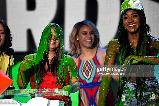 Recording artists Ally Brooke DinahJane Hansen and Normani Hamilton of music group Fifth Harmony react after getting slimed while accepting the...