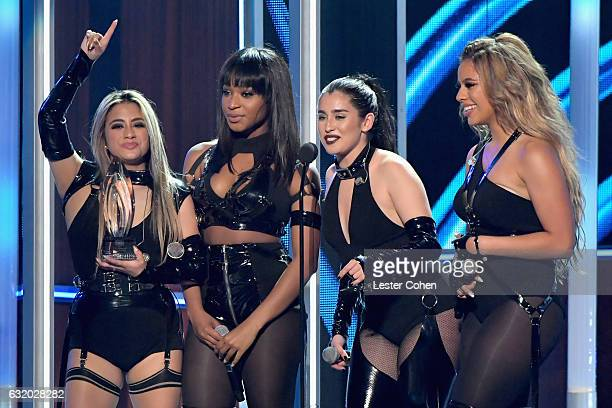 Recording artists Ally Brooke Normani Hamilton Dinah Jane Hansen and Lauren Jauregui of Fifth Harmoney accept an award onstage during the People's...