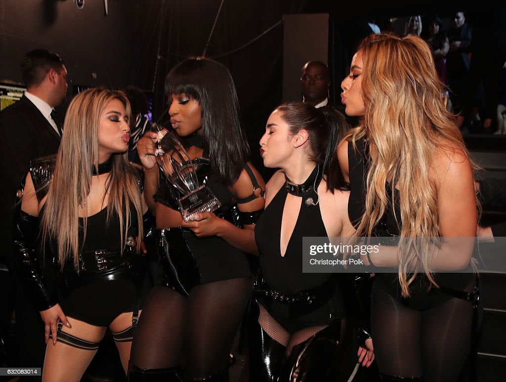 Recording artists Ally Brooke, Normani Kordei, Lauren Jauregui, and Dinah Jane of music group Fifth Harmony, winners of the Favorite Group award, pose backstage during the People's Choice Awards 2017 at Microsoft Theater on January 18, 2017 in Los Angeles, California.