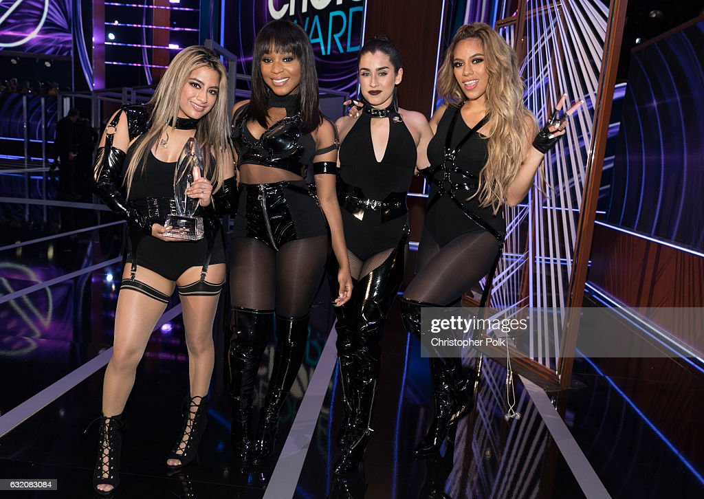Recording artists Ally Brooke, Normani Kordei, Lauren Jauregui, and Dinah Jane of music group Fifth Harmony, winners of the Favorite Group award, pose onstage during the People's Choice Awards 2017 at Microsoft Theater on January 18, 2017 in Los Angeles, California.