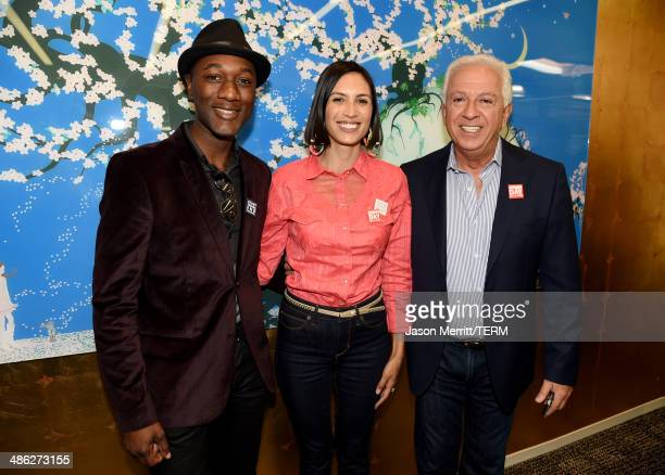 Recording artists Aloe Blacc and Maya Jupiter and cofounder of Guess Inc Paul Marciano attend the GUESS and Peace Over Violence celebration of the...