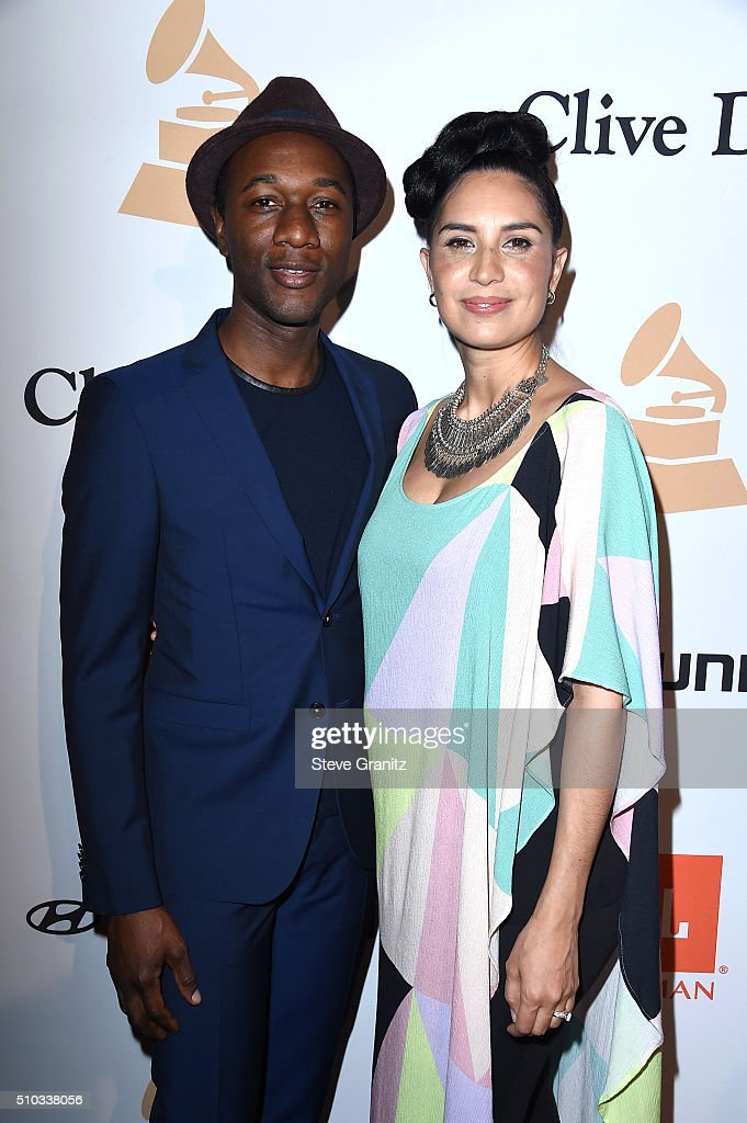 Recording artists Aloe Blacc (L) and Maya Jupiter attends the 2016 Pre-GRAMMY Gala and Salute to Industry Icons honoring Irving Azoff at The Beverly Hilton Hotel on February 14, 2016 in Beverly Hills, California.