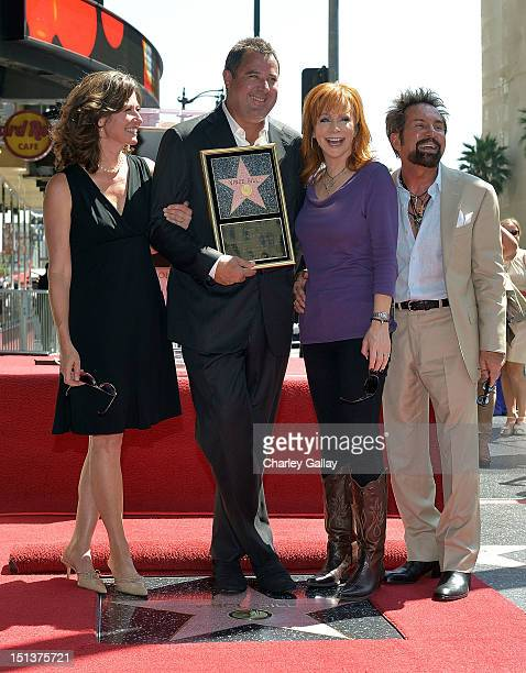 Recording artists Amy Grant Vince Gill and eba McEntire and producer Tony Brown attend Vince Gill being honored with a Star on the Hollywood Walk of...