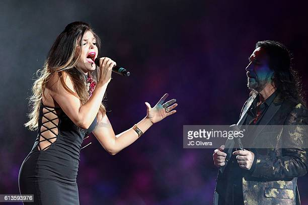 Recording artists Ana Barbara and Marco Antonio Solis AKA 'El Buki' perform ontage at Staples Center on October 8 2016 in Los Angeles California