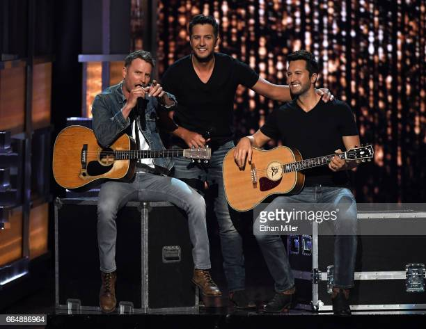 Recording artists and cohosts Dierks Bentley and Luke Bryan speak next to a wax figure of Bryan during the 52nd Academy of Country Music Awards at...
