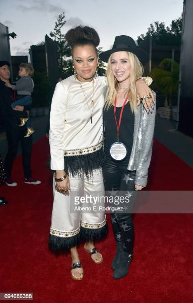 """Recording artists Andra Day and ZZ Ward pose at the after party for the World Premiere of Disney/Pixar's """"Cars 3"""" at Cars Land at Disney California..."""