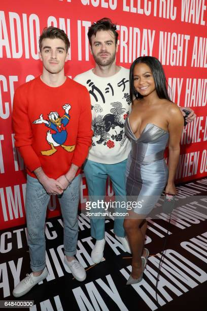 Recording artists Andrew Taggart and Alex Pall of music group The Chainsmokers and TV personality Christina Milian attend the 2017 iHeartRadio Music...