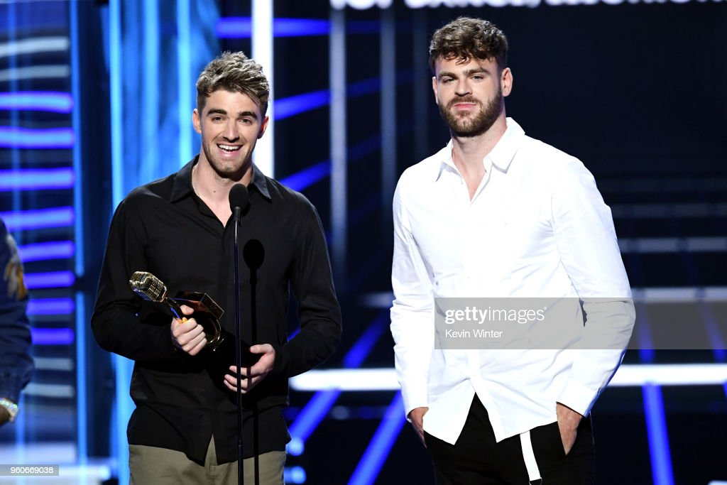 Recording artists Andrew Taggart (L) and Alex Pall of music group The Chainsmokers accept the Top Dance/Electronic Artist award onstage during the 2018 Billboard Music Awards at MGM Grand Garden Arena on May 20, 2018 in Las Vegas, Nevada.