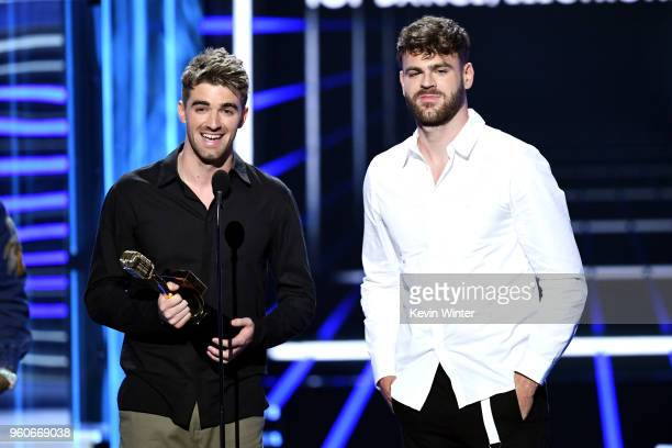 Recording artists Andrew Taggart and Alex Pall of music group The Chainsmokers accept the Top Dance/Electronic Artist award onstage during the 2018...