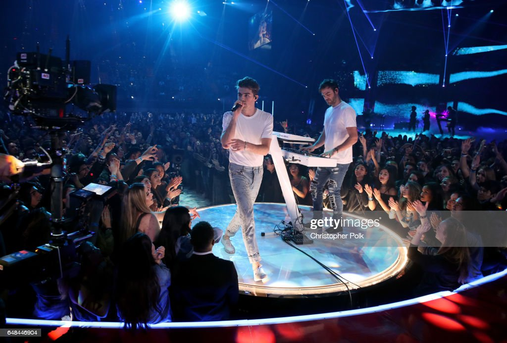 Recording artists Andrew Taggart (L) and Alex Pall of The Chainsmokers perform onstage at the 2017 iHeartRadio Music Awards which broadcast live on Turner's TBS, TNT, and truTV at The Forum on March 5, 2017 in Inglewood, California.