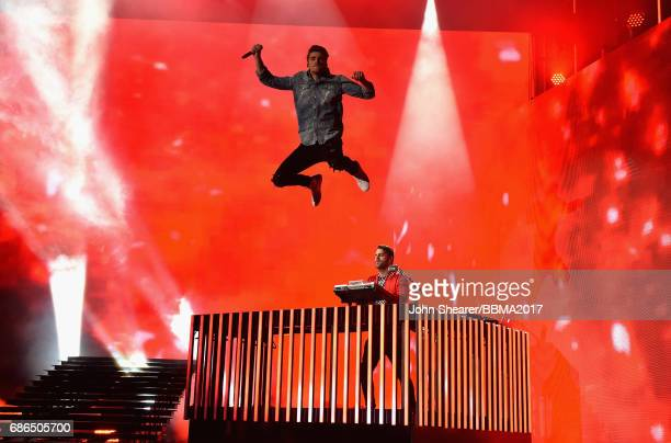 Recording artists Andrew Taggart and Alex Pall of The Chainsmokers perform onstage during the 2017 Billboard Music Awards at TMobile Arena on May 21...