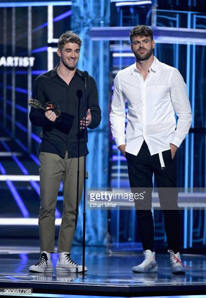 Recording artists Andrew Taggart and Alex Pall of The Chainsmokers accept an award onstage during the 2018 Billboard Music Awards at MGM Grand Garden...