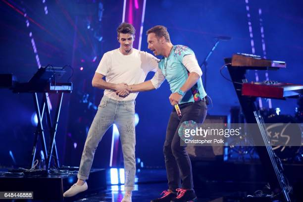 Recording artists Andrew Taggart of The Chainsmokers and Chris Martin perform onstage at the 2017 iHeartRadio Music Awards which broadcast live on...