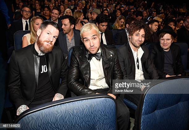 Recording artists Andy Hurley Peter Wentz Joe Trohman and Patrick Stump of music group Fall Out Boy attend The 41st Annual People's Choice Awards at...