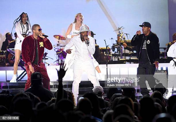 Recording artists Aqil Davidson of WreckxnEffect Teddy Riley and Markell Riley of WreckxnEffect perform onstage during the 2016 Soul Train Music...