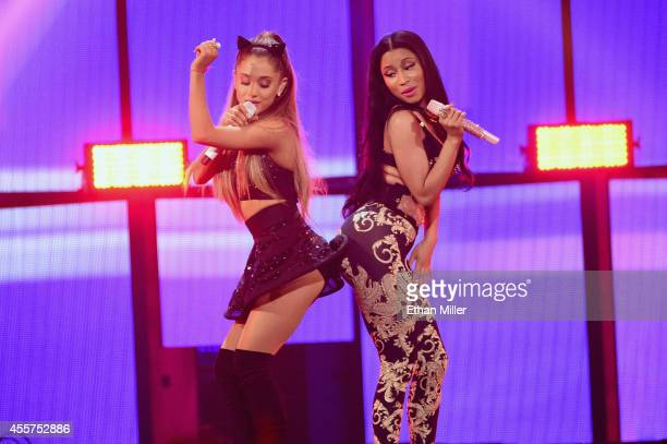Recording artists Ariana Grande and Nicki Minaj perform onstage during the 2014 iHeartRadio Music Festival at the MGM Grand Garden Arena on September...