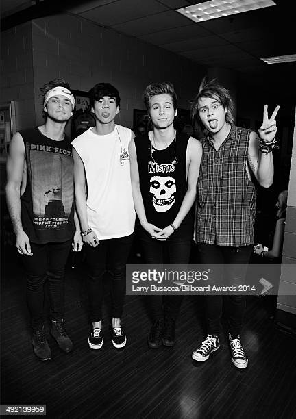 Recording artists Ashton Irwin Calum Hood Luke Hemmings and Michael Clifford of 5 Seconds of Summer attend the 2014 Billboard Music Awards at the MGM...