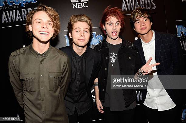 Recording artists Ashton Irwin, Luke Hemmings, Michael Clifford and Calum Hood of music group 5 Seconds of Summer attend the PEOPLE Magazine Awards...