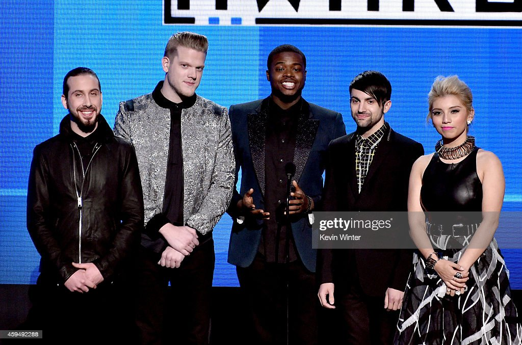 Recording artists Avi Kaplan, Scott Hoying, Kevin Olusola, Mitch Grassi, and Kirstie Maldonado of music group Pentatonix speak onstage at the 2014 American Music Awards at Nokia Theatre L.A. Live on November 23, 2014 in Los Angeles, California.