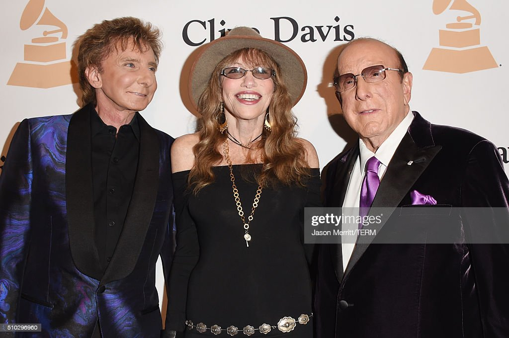 Recording artists Barry Manilow, Carly Simon and host Clive Davis attend the 2016 Pre-GRAMMY Gala and Salute to Industry Icons honoring Irving Azoff at The Beverly Hilton Hotel on February 14, 2016 in Beverly Hills, California.