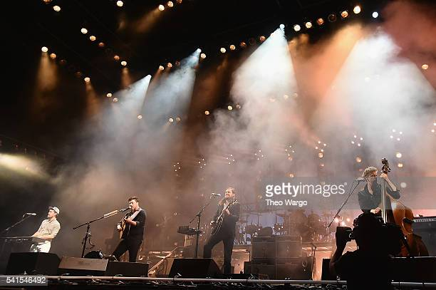 Recording artists Ben Lovett Marcus Mumford Winston Marshall and Ted Dwane of Mumford Sons perform onstage during the Firefly Music Festival on June...