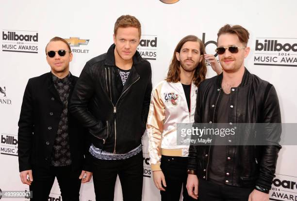 Recording artists Ben McKee Dan Reynolds Wayne Sermon and Daniel Platzman of Imagine Dragons arrive at the 2014 Billboard Music Awards at the MGM...