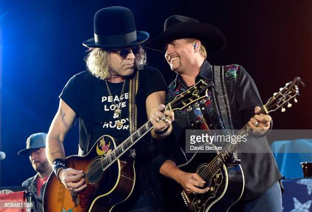 Recording artists Big Kenny and John Rich of Big Rich perform during the Route 91 Harvest country music festival at the Las Vegas Village on October...
