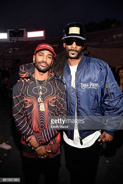 """Recording artists Big Sean and Snoop Dogg pose backstage during """"The Formation World Tour"""" at the Rose Bowl on May 14, 2016 in Pasadena, California."""