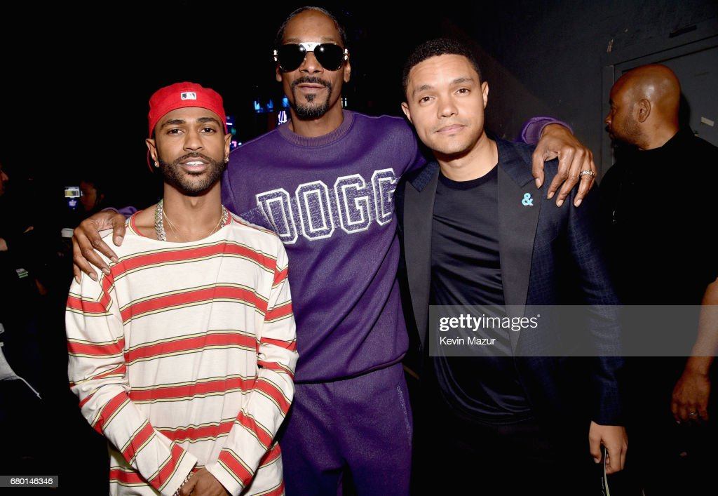 Recording artists Big Sean, Snoop Dogg, and TV personality Trevor Noah attend the 2017 MTV Movie And TV Awards at The Shrine Auditorium on May 7, 2017 in Los Angeles, California.