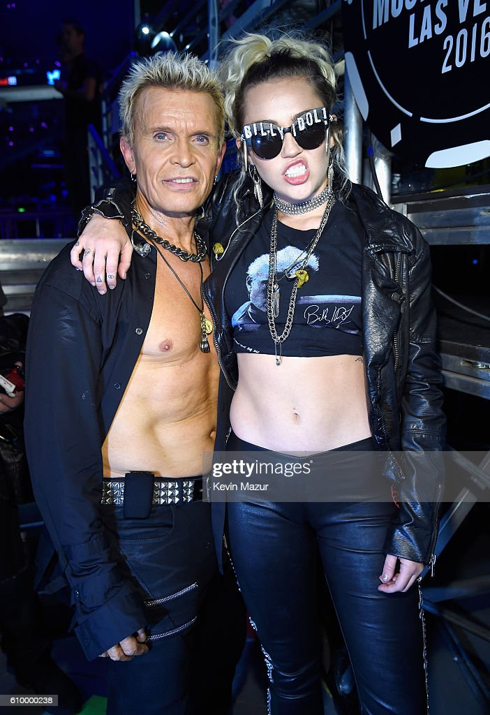 Recording artists Billy Idol (L) and Miley Cyrus pose backstage at the 2016 iHeartRadio Music Festival at T-Mobile Arena on September 23, 2016 in Las Vegas, Nevada.