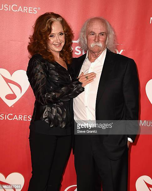 Recording artists Bonnie Raitt and David Crosby attend the 25th anniversary MusiCares 2015 Person Of The Year Gala honoring Bob Dylan at the Los...