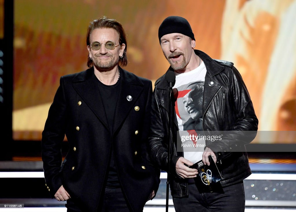 Recording artists Bono (L) and The Edge of music group U2 speak onstage during the 60th Annual GRAMMY Awards at Madison Square Garden on January 28, 2018 in New York City.