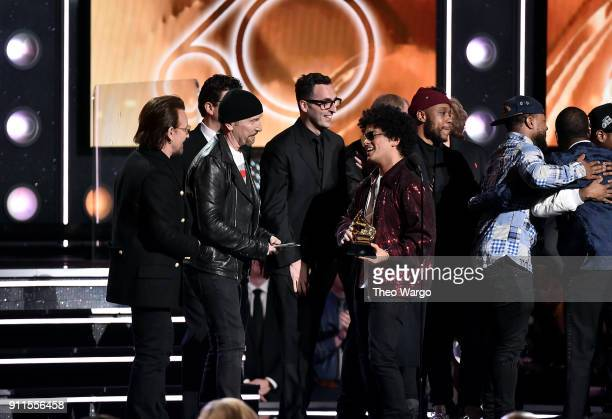 Recording artists Bono and The Edge of musical group U2 present the Album Of The Year award for '24K Magic' to recording artist Bruno Mars onstage...