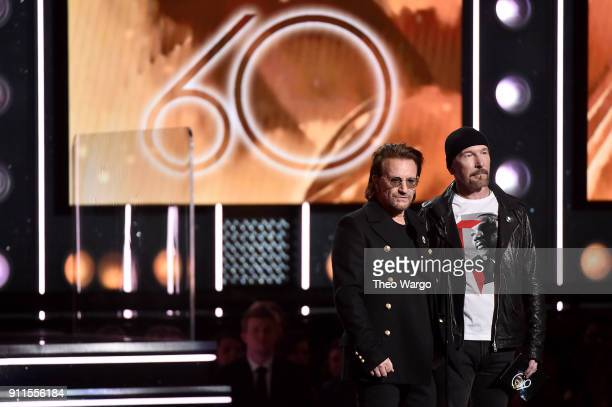 Recording artists Bono and The Edge of musical group U2 speak onstage during the 60th Annual GRAMMY Awards at Madison Square Garden on January 28...
