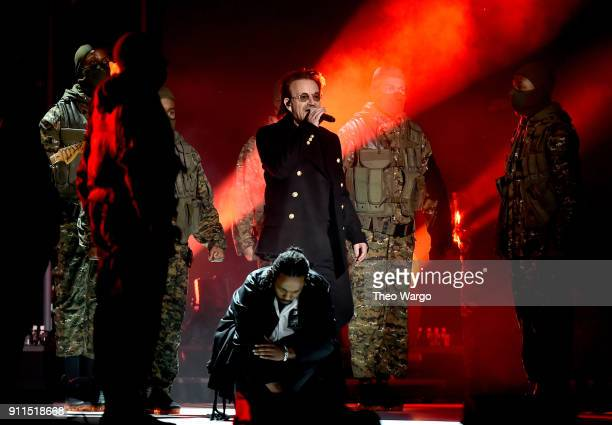 Recording artists Bono of musical group U2 and Kendrick Lamar perform onstage during the 60th Annual GRAMMY Awards at Madison Square Garden on...