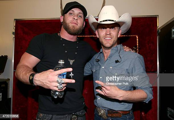 Recording artists Brantley Gilbert and Justin Moore attend the 2015 iHeartRadio Country Festival at The Frank Erwin Center on May 2 2015 in Austin...