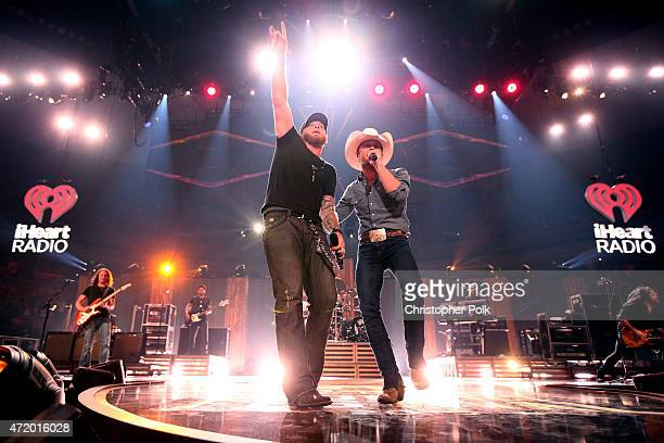Recording artists Brantley Gilbert and Justin Moore perform onstage during the 2015 iHeartRadio Country Festival at The Frank Erwin Center on May 2...