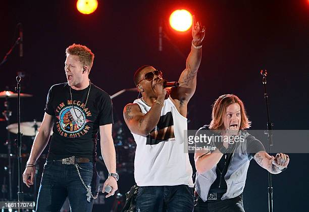 Recording artists Brian Kelley and Tyler Hubbard of Florida Georgia Line perform with rapper Nelly onstage during Tim McGraw's Superstar Summer Night...