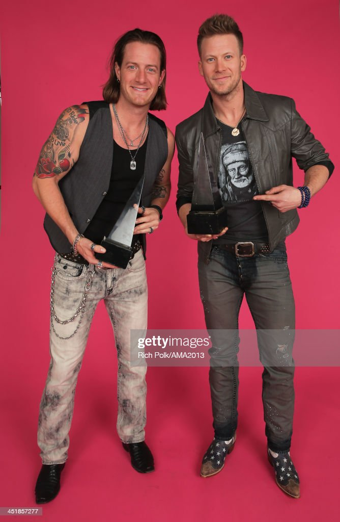 Recording artists Brian Kelley (R) and Tyler Hubbard of Florida Georgia Line pose for a portrait during the 2013 American Music Awards at Nokia Theatre L.A. Live on November 24, 2013 in Los Angeles, California.