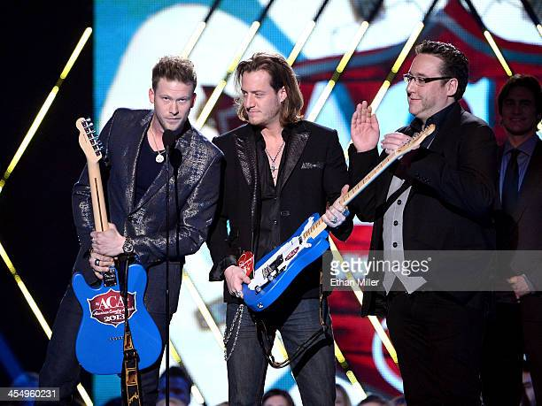Recording artists Brian Kelley and Tyler Hubbard of Florida Georgia Line accept the Single of the Year award onstage during the American Country...