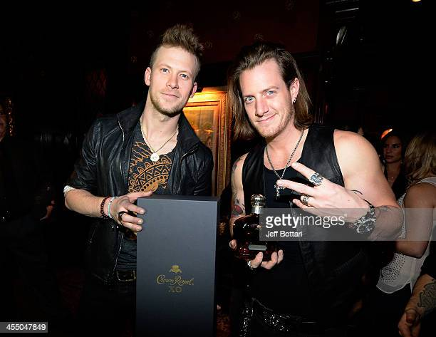 Recording artists Brian Kelley and Tyler Hubbard of Florida Georgia Line celebrate an extraordinary night with a bottle of the new Crown Royal XO at...