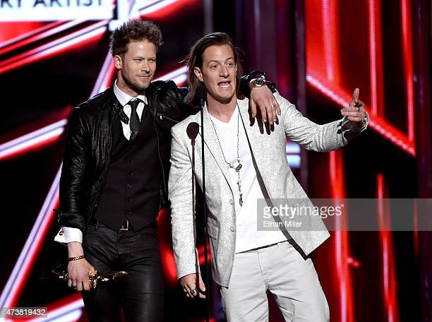 Recording artists Brian Kelley and Tyler Hubbard of Florida Georgia Line accept the Top Country Artist award onstage during the 2015 Billboard Music...