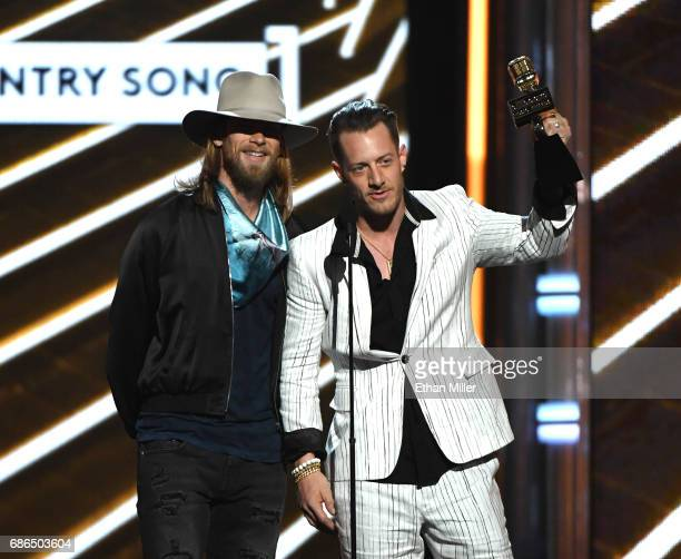 Recording artists Brian Kelley and Tyler Hubbard of Florida Georgia Line accept the Top Country Song award for 'HOLY' onstage during the 2017...