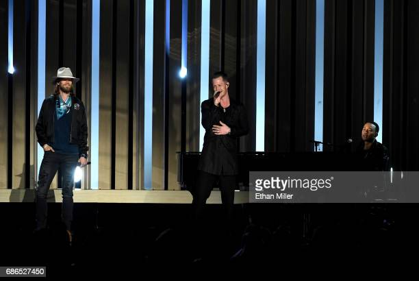 Recording artists Brian Kelley and Tyler Hubbard of Florida Georgia Line perform with recording artist John Legend onstage during the 2017 Billboard...