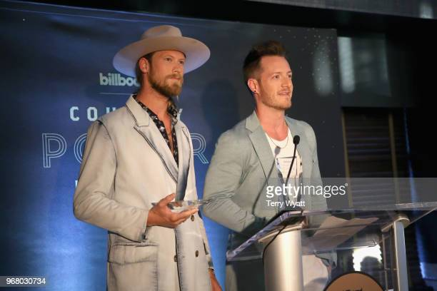 Recording artists Brian Kelley and Tyler Hubbard of Florida Georgia Line speak onstage as Billboard celebrates the Country Music industry with...