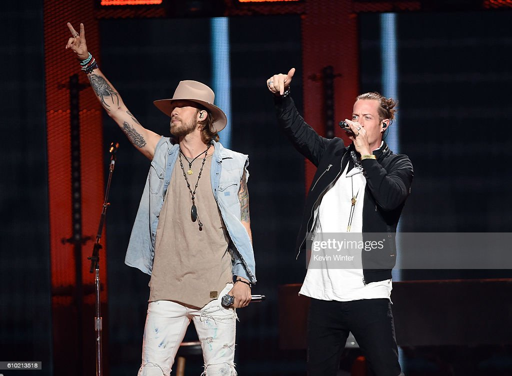 Recording artists Brian Kelley (L) and Tyler Hubbard of music group Florida Georgia Line perform onstage at the 2016 iHeartRadio Music Festival at T-Mobile Arena on September 24, 2016 in Las Vegas, Nevada.