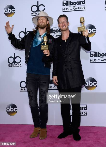 Recording artists Brian Kelley and Tyler Hubbard of music group Florida Georgia Line winners of the Top Country Song award for 'HOLY' pose in the...