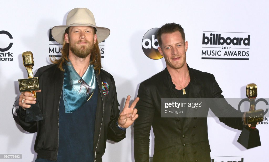 Recording artists Brian Kelley (L) and Tyler Hubbard of music group Florida Georgia Line pose with the 'Top Country Song' award at the 2017 Billboard Music Awards at T-Mobile Arena on May 21, 2017 in Las Vegas, Nevada.